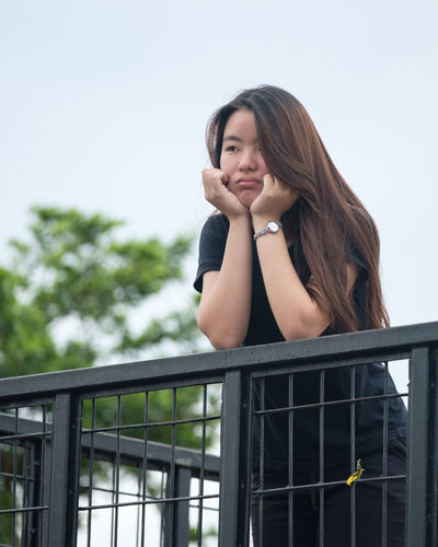 grim expression ASIA Asian  Beautiful Adult Architecture Asian Girl Beauty Cute Cute Girl Day Dyed Hair Expression Girl Gorgeous Lifestyles Long Hair Lovely No Makeup One Person Oriental Outdoors People Railing Real People Sky Smiling Sweet Girl Young Adult Young Women
