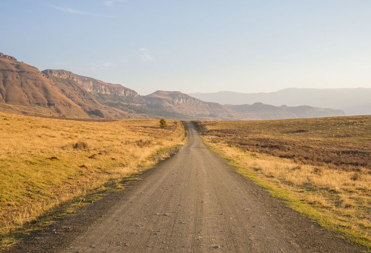 Drakensberg, South Africa Drakensburg Mountains, South Africa, Mountain Hiking Beauty In Nature Day Drakensberg Landscape Mountain Mountain Range Nature No People Outdoors Road Scenics Sky The Way Forward Tranquil Scene Tranquility Transportation