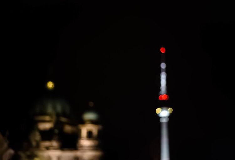 Defocused tower at night