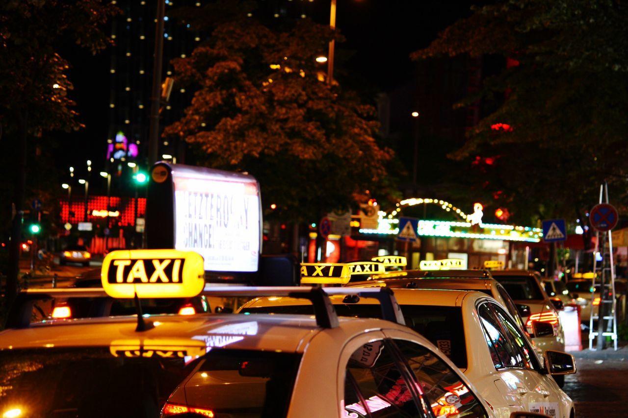illuminated, text, night, car, transportation, mode of transport, communication, land vehicle, no people, city, outdoors, tree, neon
