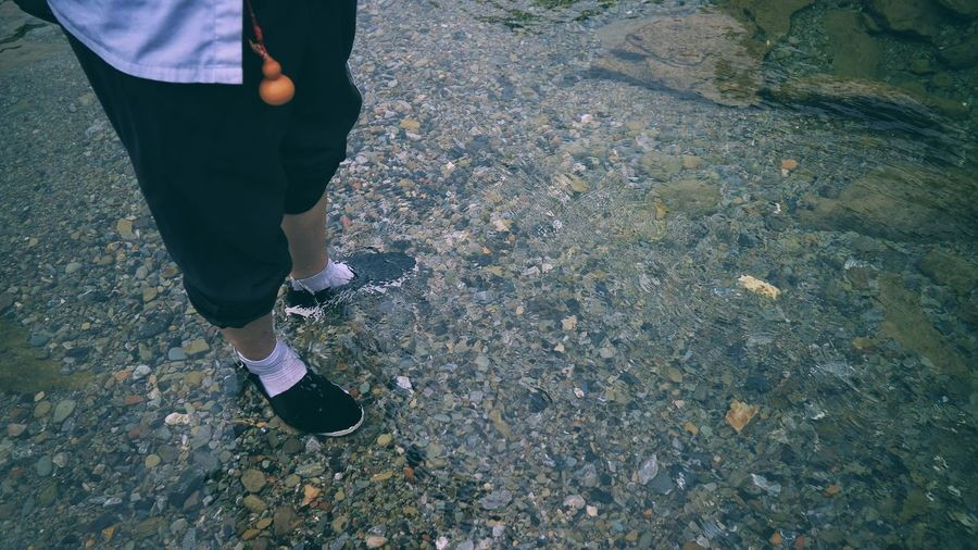 Low Section Human Leg Standing Only Men Men Adults Only Human Body Part Adult One Person One Man Only Shoe Casual Clothing People High Angle View Day Outdoors The Great Outdoors - 2017 EyeEm Awards The Human Condition Water Out Of The Box