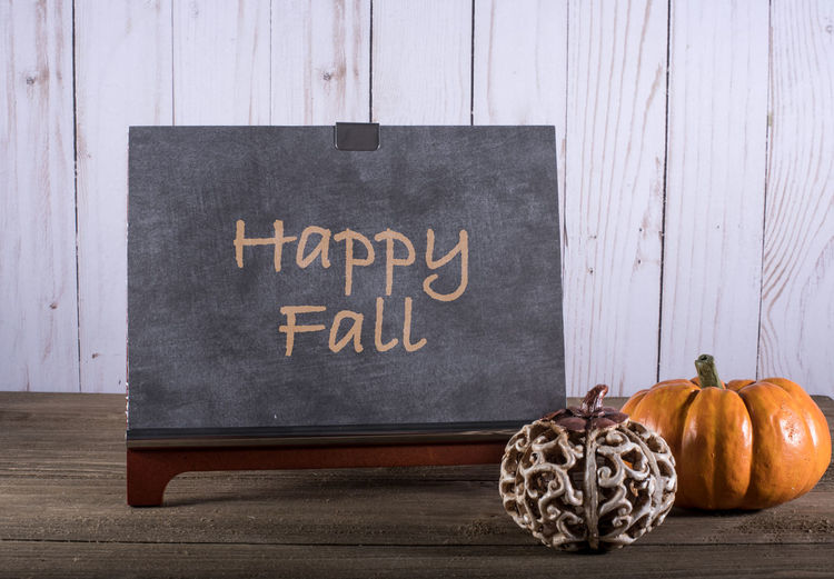 Chalkboard with words Happy Fall and pumpkins Autumn Fall Colors Text Thankgsiving Chalk Chalkboard Day Fall Food Freshness Halloween Indoors  No People Pumpkin Vegetable