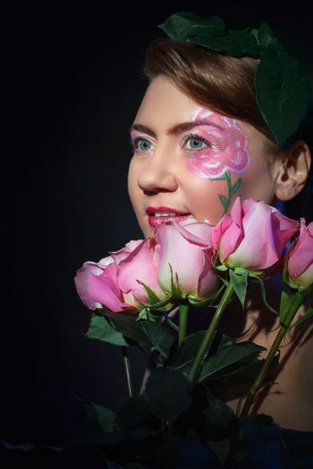 Beautiful portrait of a woman with rose petals on the head, a rose painted around the eye and very beautiful roses in her arms Beautiful Elégance Fairytale  Hair Lipstick Makeup Romance Romantic Valentine's Day  Being Happy Bouquet Cosmetics Eye Face Flowers Hairstyle Human Body Part Ornaments Painting Portrait Rose Image Roses Smile Studio Shot Women