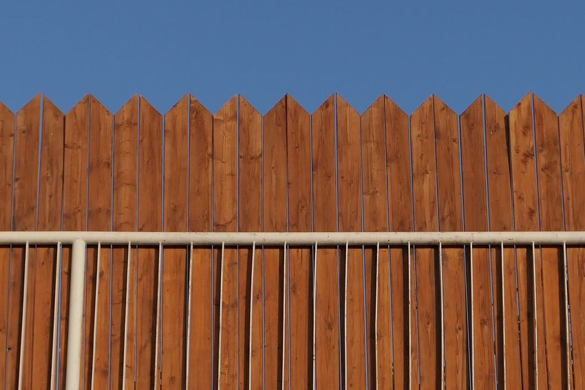 Pattern Wood - Material Brown No People Day Sky Metal Security Fence Blue Barrier Sunlight Side By Side Protection Clear Sky Outdoors