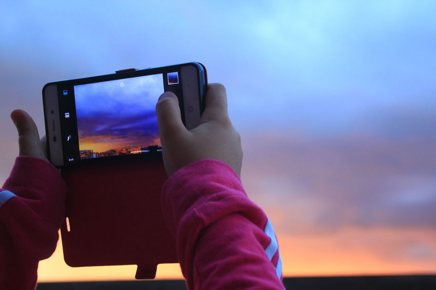 Check This Out Cloud - Sky Dramatic Sky EyeEm Gallery Focus On Foreground Girl Hand Holding Internet Addiction Leisure Activity Majestic Mobile Phone No Edit/no Filter Photographing Photography Themes Pink Color Sky Smart Phone Storm Cloud Storm Clouds At Sunset Sunset Taking Pictures Taking Pictures Of People Taking Pictures The Purist (no Edit, No Filter) Touch Screen The Color Of Technology
