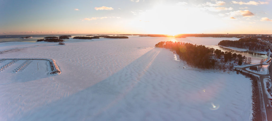 Icy snow covered Baltic sea at Winter Beauty In Nature Cold Temperature Day Ethereal Frozen Idyllic Landscape Lens Flare Nature No People Outdoors Reflection Scenics Sea Sky Snow Sun Sunbeam Sunlight Sunset Tranquil Scene Water Winter