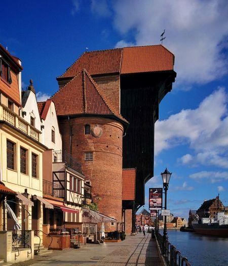 The medieval port crane Zuraw in Gdansk, Poland Żuraw Crane Medieval Port Danzig Gdansk Poland Europe Landmark Motława River Harbor Harbour Architecture Sightseeing Building Day City Outdoors Building Exterior Architecture Travel Destinations