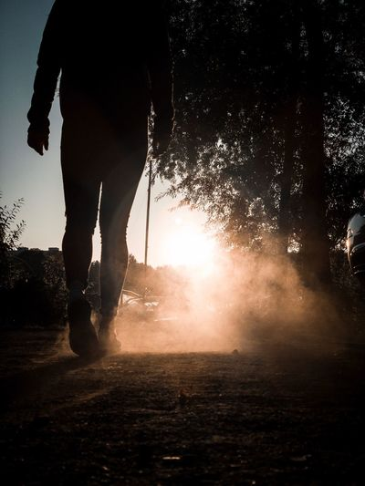 Dust. One Person Men Nature Lifestyles Water Silhouette Real People Sunlight Motion Outdoors Standing Human Leg EyeEmNewHere EyeEmNewHere