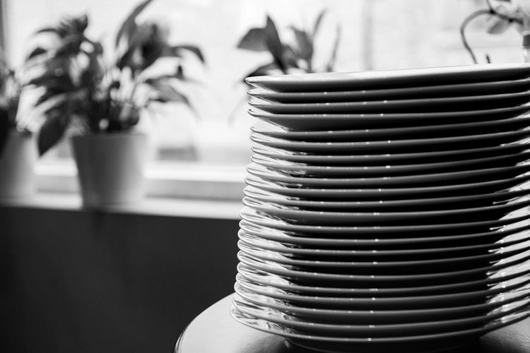 Stack of plates on table at home