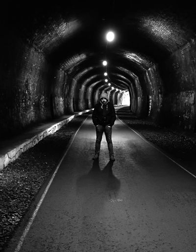 Tunnel Full Length One Person Adult Indoors  Illuminated People Real People Adults Only Only Women One Woman Only Day Man Men Bad Guy Blackandwhite Darkness And Light Architecture Built Structure Fear United Kindom Old Buildings Location