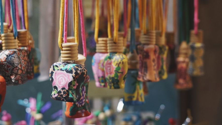 Close-up of decorative materials hanging for sale