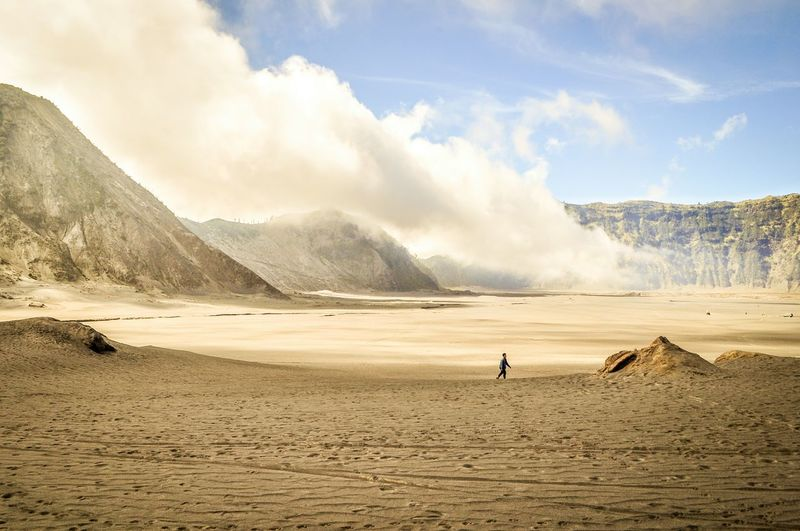 Person On Field At Mt Bromo Against Sky