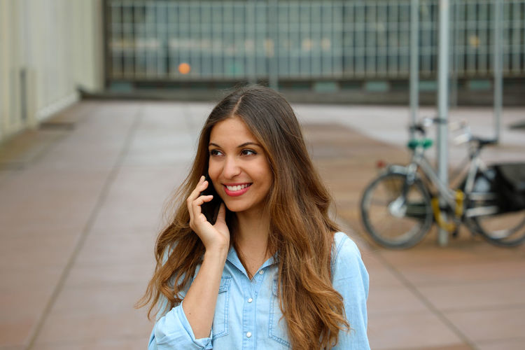 Business woman in Eindhoven Business Women Woman Adult Beautiful Woman Brown Hair Business Finance And Industry Business Woman Communication Connection Emotion Focus On Foreground Front View Hair Hairstyle Happiness Long Hair One Person Portrait Smiling Technology Telephone Wireless Technology Woman Portrait Women Young Adult