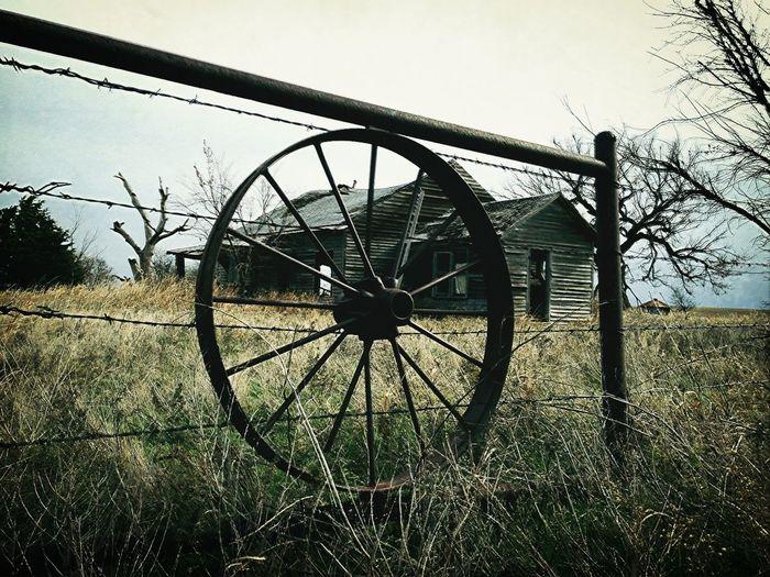 Wagon Wheel At Abandoned House
