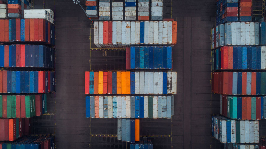 Industrial port with containers. Aerial View Business Cargo City Commercial Container Crane Delivery Export Freight Global Goods Harbor Import Industrial Logistics Port Sea Ship Shipment Shipping  Stack Storage Terminal Warehouse Fresh On Market 2017