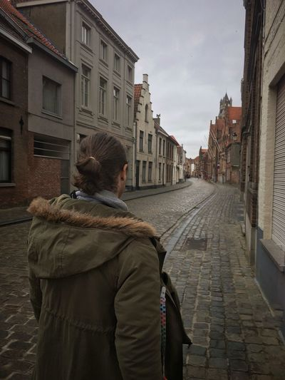 Rear View Followme I Will Follow Lead The Way Manbun Long Hair Building Exterior One Person Real People Lifestyles City Warm Clothing Streetphotography Cobblestone Europe Bruges Brugge