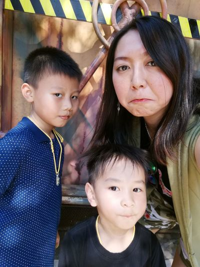 Portrait Of Woman With Sons Outdoors