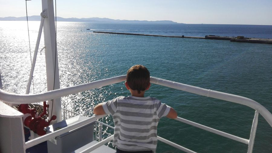 Unrecognizable Person Summer Holiday Travel Photography Sunny Day Looking Away Ship Little Boy Water Rear View Sea Railing Real People Lifestyles Leisure Activity Childhood Casual Clothing Nautical Vessel One Person