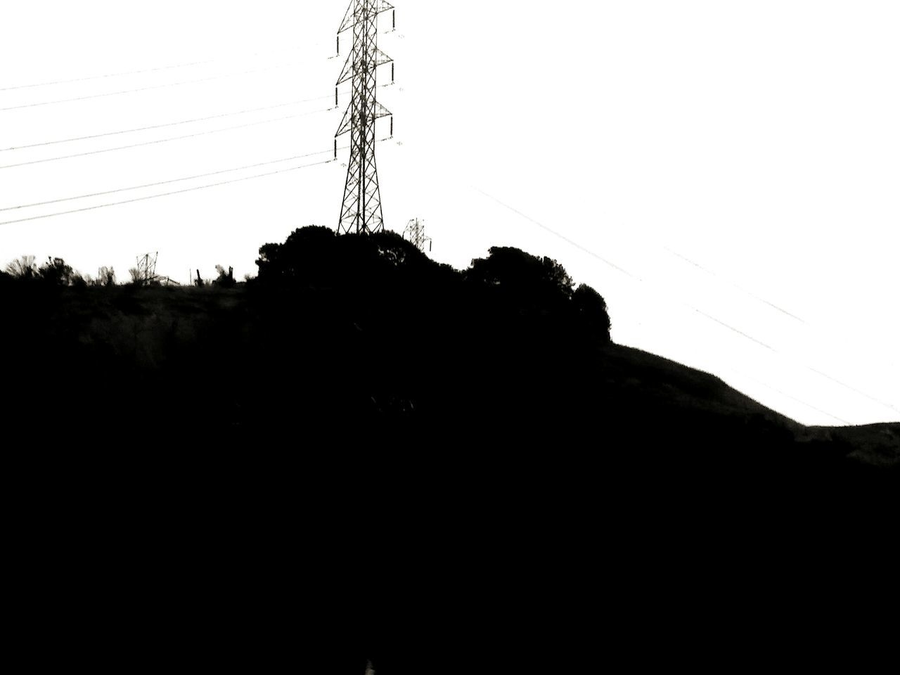 cable, silhouette, power line, clear sky, electricity, sky, low angle view, nature, day, outdoors, beauty in nature, no people, landscape, electricity pylon, mountain