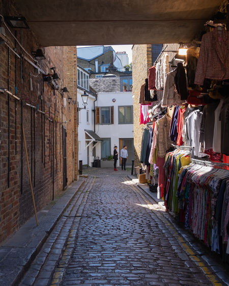 Alley Architecture Building Building Exterior Built Structure Choice City Clothing Day Direction Footpath For Sale Market Market Stall No People Outdoors Residential District Retail  Retail Display Street Street Market The Way Forward