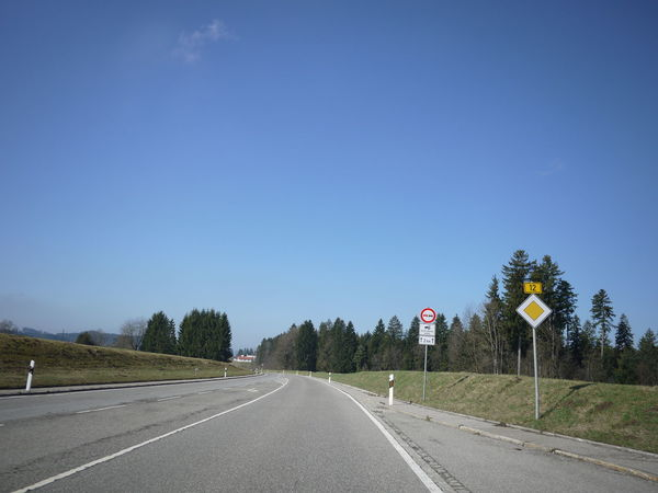 Trafficsign in south Germany Allgäu Guiding Traffic Asphalt Blue Clear Sky Day Direction Empty Guidance Guide Nature No People Outdoors Road Road Marking Road Sign Sky Speed Limit Sign Street The Way Forward Traffic Sign Transportation Tree Warning Sign White Line
