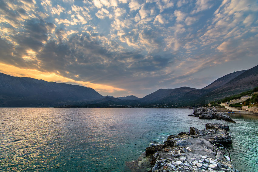 Kotronas during sunset, Mani, Greece Cloudscape Nature Beauty In Nature Cloud - Sky Day Greece Idyllic Kotronas Lake Lakonias Landscape Mani Mountain Mountain Range Nature No People Outdoors Scenics Sea And Clouds Sky Sunset Tranquil Scene Tranquility Water