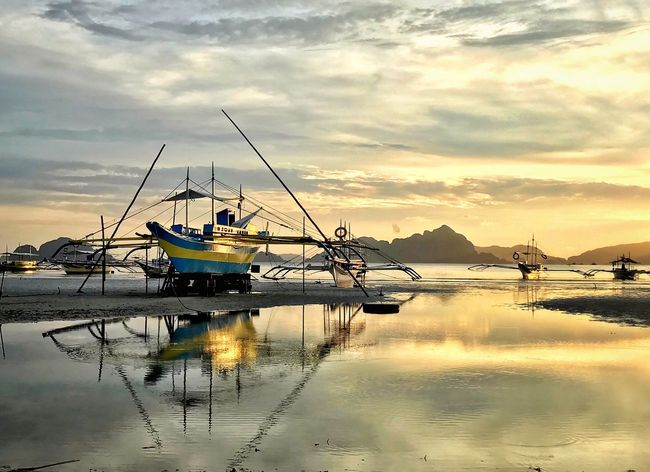 Time to pause, reflect and be refreshed! Sunset_collection Palawan El Nido Travel Destinations Eyeem Philippines EyeEm Nature Lover Eye4photography  EyeEm Best Shots Travel Photography EyeEm Gallery Life Is A Beach Enjoying Life Enjoying The View Water Sky Cloud - Sky Nautical Vessel Reflection Transportation Mode Of Transportation Beauty In Nature Nature Scenics - Nature Tranquility Tranquil Scene