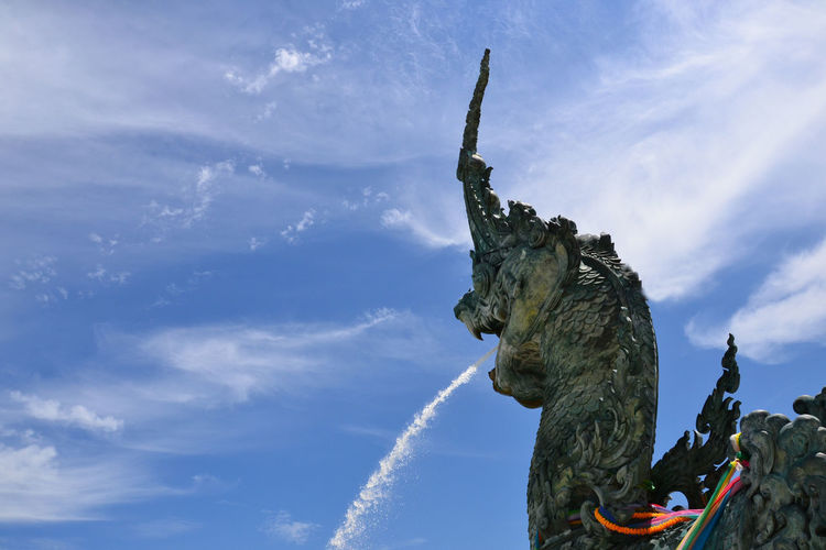 Statue Sculpture Fountain Cloud - Sky Sky Blue Outdoors Travel Destinations Spraying Day No People Thailand Travel Beauty In Nature Vacations Statue Architecture Dragon Spraying Art And Craft