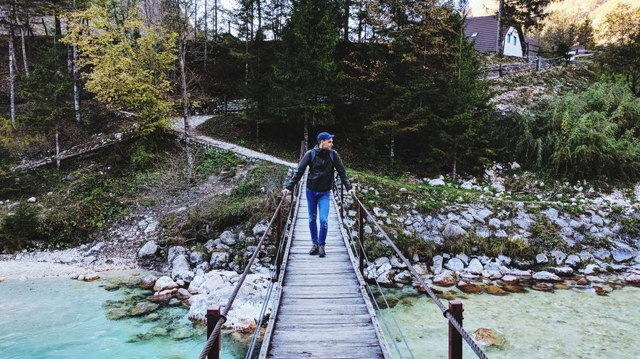 Real People Full Length One Person Day Rear View Nature Standing Outdoors Lifestyles Leisure Activity Tree Men Water Beauty In Nature Adult Adults Only People Only Men Backpack Hiker Hiking Adult River Bridge Soca