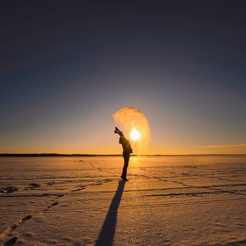 Sunset Sun One Person Beach Sand Outdoors Sea Nature Sky Motion Water Beauty In Nature People Adults Only Adult Wire Wool Day