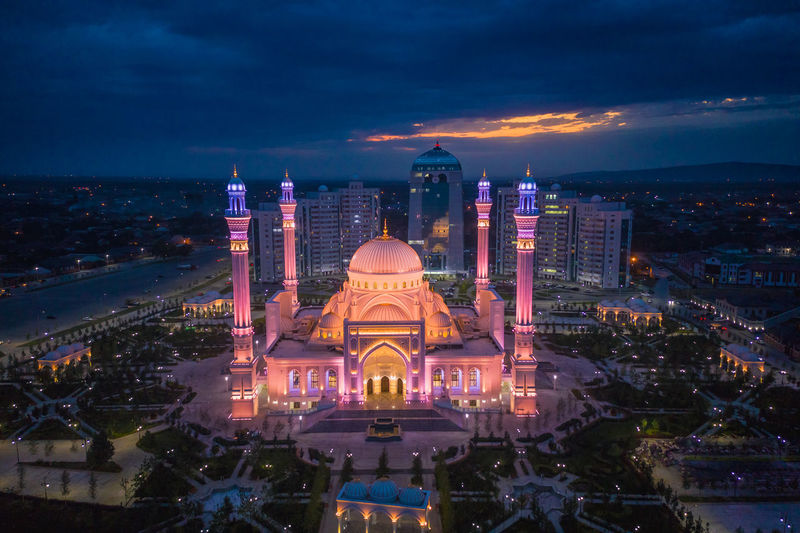 Mosque named after the prophet muhammad in the city of shali. illuminated buildings in city at night