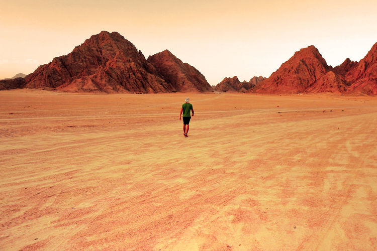 Full length of man walking on desert