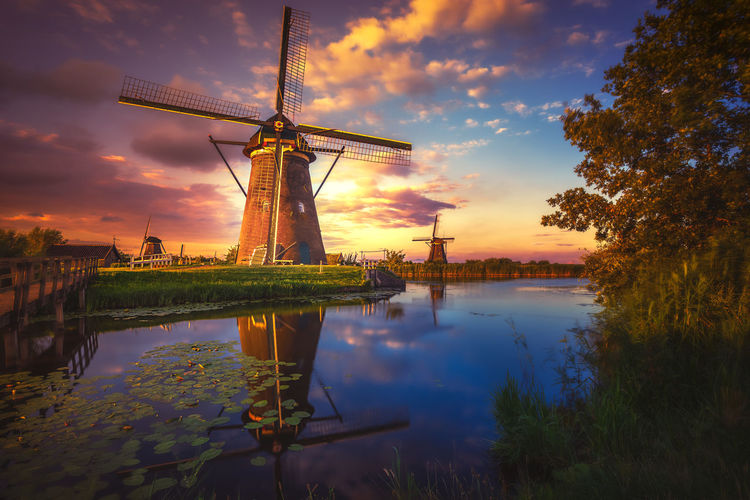 Kinderdijk Amsterdam Sunset Remo SCarfo EyeEm Best Shots EyeEmNewHere EyeEm Gallery Sky Water Fuel And Power Generation Environmental Conservation Reflection Renewable Energy Alternative Energy Cloud - Sky Wind Turbine Turbine Wind Power Nature Environment Plant Beauty In Nature Scenics - Nature Traditional Windmill No People Outdoors