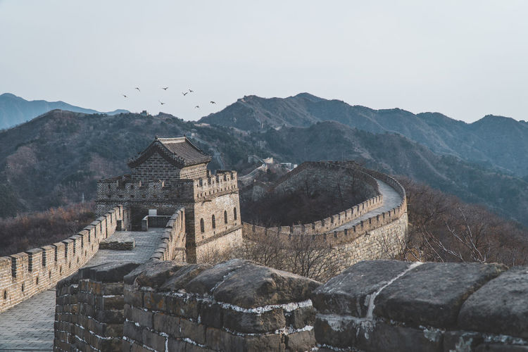 The great wall of china - Mutianyu Mountain Architecture Built Structure History Sky The Past Building Exterior Travel Destinations Travel Mountain Range Nature Tourism Scenics - Nature No People Day Ancient Wall Building Fog Ancient Civilization Outdoors Stone Wall