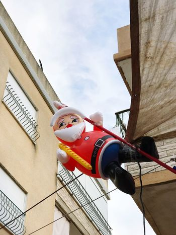 Sky Low Angle View Building Exterior Real People Day Architecture Airplane Cloud - Sky Outdoors One Person מייחגים מייאייפון7 מייתרשיחא Christmas Decoration Santa
