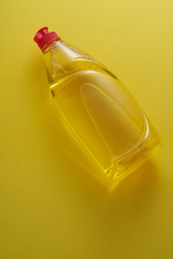 Close-up of bottle against yellow background