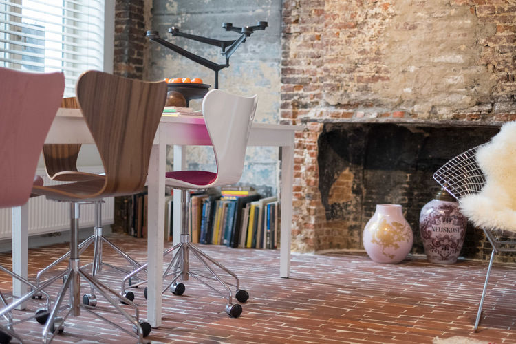 Table and chairs against wall