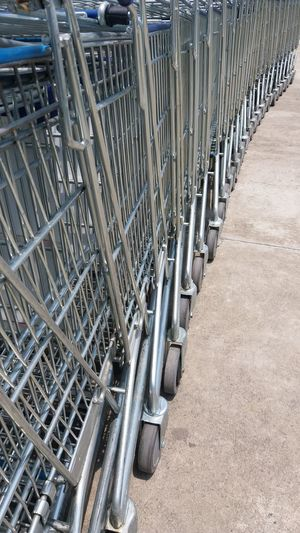 High angle view of shopping cart in row