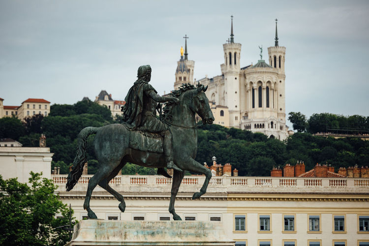 Equestrian Statue of Louis XIV on Place Bellecour in the old town of Lyon. Ancient France King Louis XIV Lyon Architecture Art And Craft Building Building Exterior Built Structure City Day History Horse Human Representation Old Outdoors Representation Sculpture Statue The Past Travel Destinations