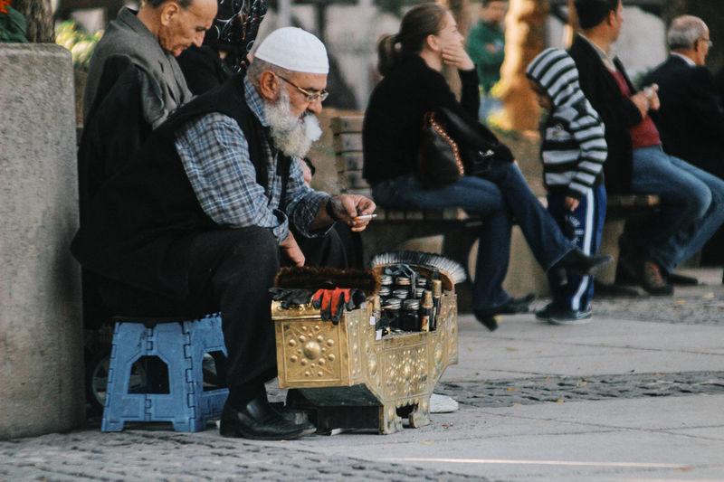 People sitting on street in winter