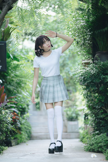 Student wearing school uniform while standing in park