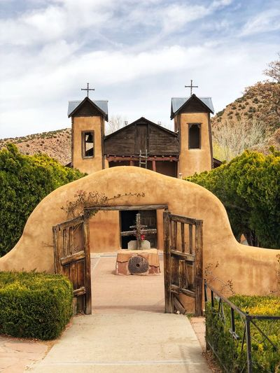 Chimayo, New Mexico a holy catholic place where many from all over the world come to visit. EyeEm Best Shots EyeEm Architecture Built Structure Building Exterior Sky Building Plant Cloud - Sky Place Of Worship Religion Nature Spirituality Belief The Way Forward Outdoors Day Tree Entrance Arch No People