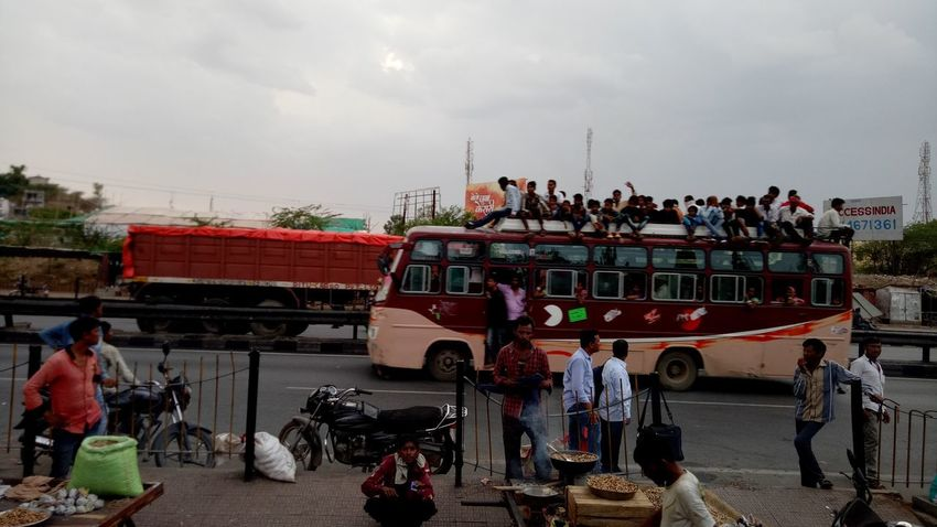 Large Group Of People Motorcycle Transportation Men Adult People Sitting Women Outdoors Sky Headwear Adults Only Crowd Day Fan - Enthusiast Only Men Motion Many People Many People Sitting On Bus Top