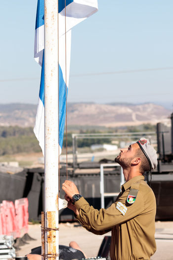 Nahariya, Israel, June 29, 2017 : Soldier of the IDF raices the flag at the evening formation in Nahariya, Israel Army Battle Ceremony Day Defense Education Force Idf Israel Defense Forces Israeli Jewish Military Outdoors Parade Patriotism People Professional Protection Service Soldier Training Uniform War Warrior Weapon