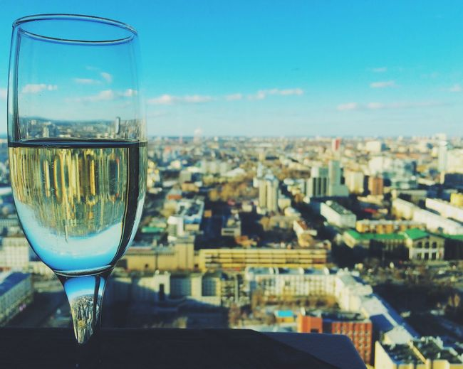 Close-Up Of Champagne With City In Background
