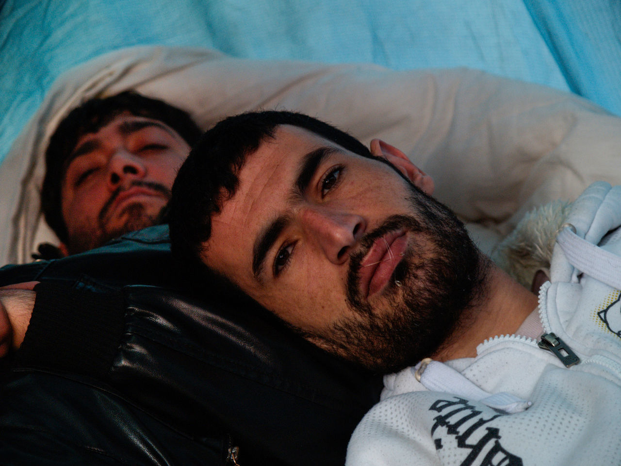 bed, mid adult men, two people, indoors, real people, young men, headshot, beard, lying down, close-up, young adult, bedroom, men, day, people