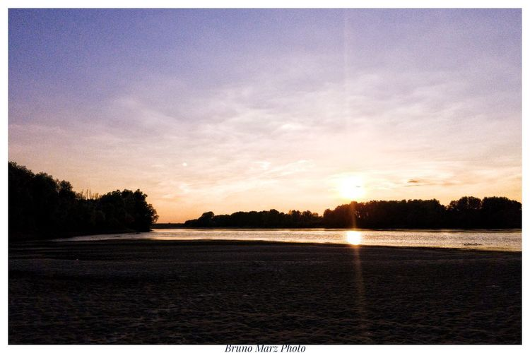 Dentro il Po River Sand Water Wateraddict Sun Sunset Blue Sky Violetsky Bluehour Sunonthewater Tree Sunset Water Lake Sky Calm Horizon Over Water First Eyeem Photo
