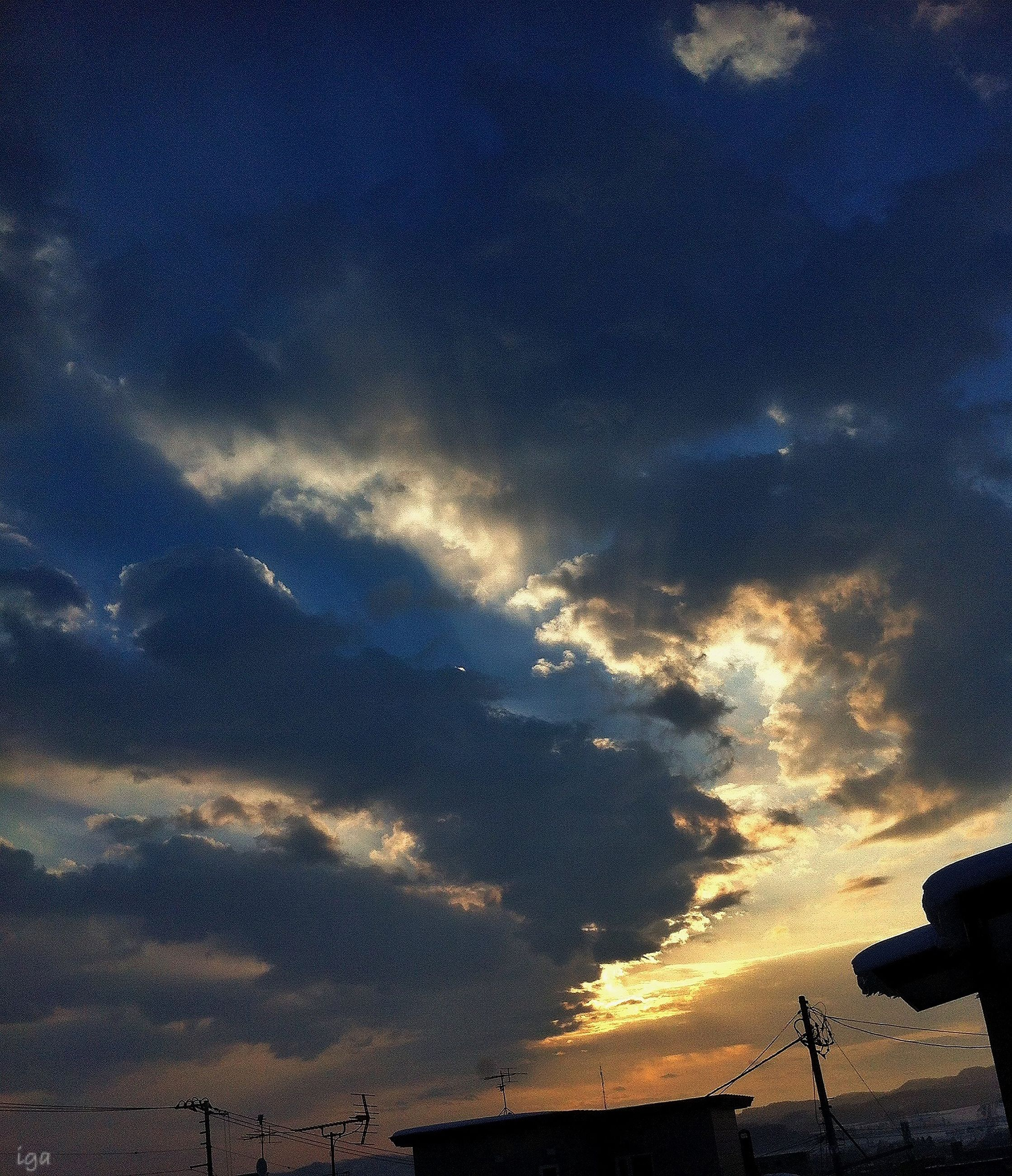 sky, cloud - sky, silhouette, sunset, low angle view, cloudy, scenics, tranquility, dusk, beauty in nature, tranquil scene, nature, cloud, outdoors, dramatic sky, sunlight, no people, weather, cloudscape, dark