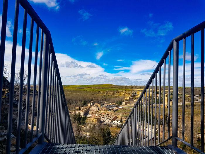Panoramic view of bridge against blue sky