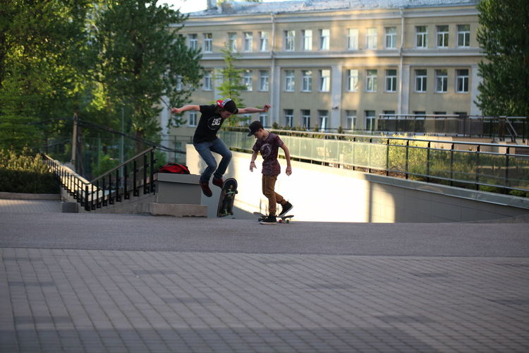 Architecture Transportation Built Structure Full Length City Real People Building Exterior Plant Lifestyles People Street Day Bicycle Women Men Nature Adult Land Vehicle Tree Footpath Outdoors Riding